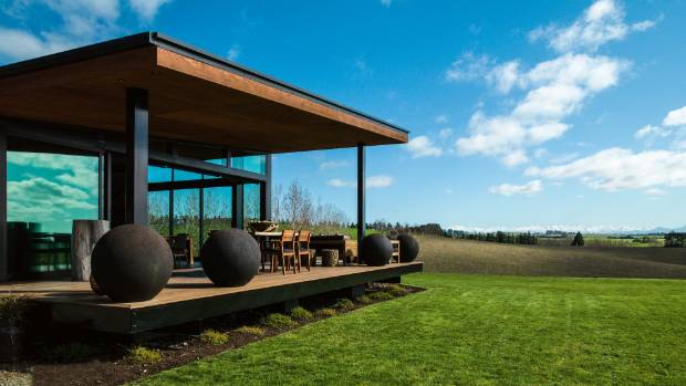 Metal shavings give a rusted effect to the concrete spheres from Garden Classics in Christchurch on the deck.