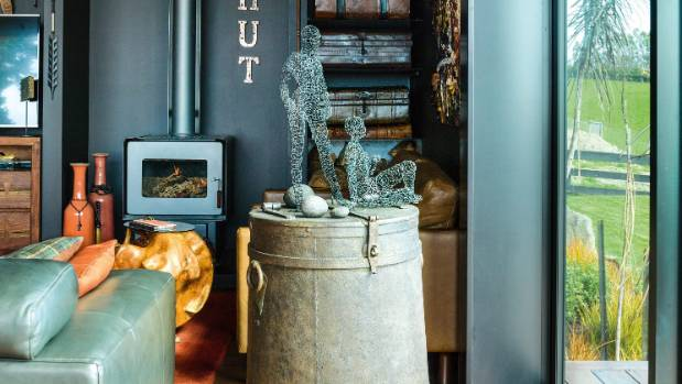A vintage Indian grain urn displays Yolande's favourite art objects.