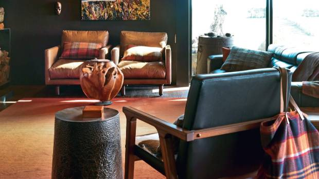 The 1970s tobacco leather chairs and the wooden-burr coffee table are from Bali.