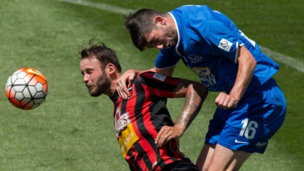 Canterbury United's Stephen Hoyle faces pressure from Hamilton Wanderers' Sam O'Regan.