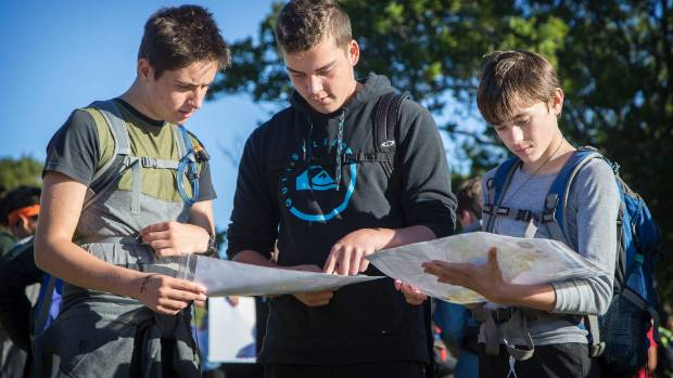 Inglewood High School students Taylor Russell, 15, Jack Bishop, 15, and Corban Butler, 14, assess the map.