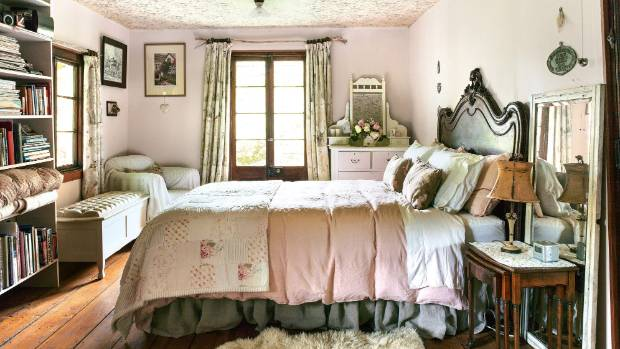 "Bronwyn ""slapped some pale pink paint"" over the existing 1980s wallpaper in the master bedroom and the couple ..."