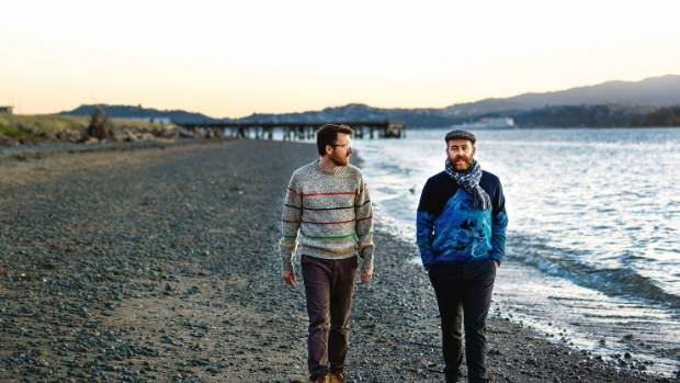 Nigel, left, and Brian love strolling along Rona Bay beach.