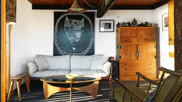 The Japanese sofa by Ritzwell in the living room is a honeymoon present the couple bought for each other; beside it is a ...