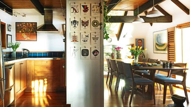 he kitchen is separated from the dining area by a wall, used for storage and to display a group of works by Richard Killeen.