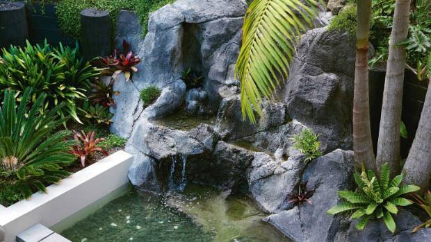 Custom-made artificial rock was used to construct the water feature; as it ages, and plants and lichen grow over the ...