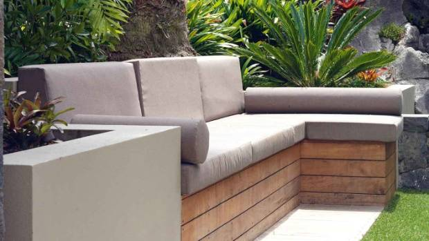 The outdoor sofa was built on top of an existing retaining wall.