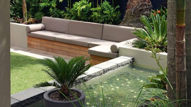 A baby cycad and its more mature relation bookend the water feature; they are slow-growing, sculptural plants that need ...