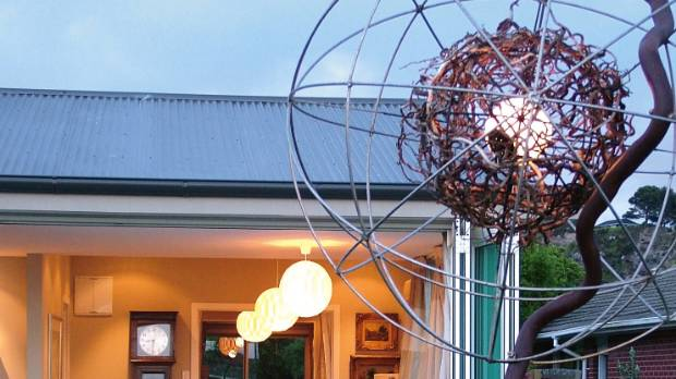 One of Dan's sculptures lights up the garden; made for a Christchurch property, it was moved to Wanaka after the quakes.