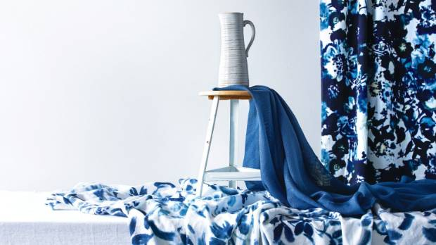 On table, Designers Guild Brera Lino in Alabaster, left, Designers Guild Cellini in Zinc, right, both from Icon ...