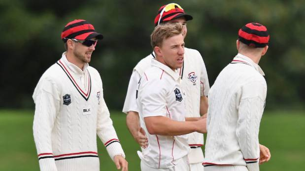 Logan van Beek of Canterbury is congratulated by team mates after dismissing Michael Bracewell of Otago during the ...
