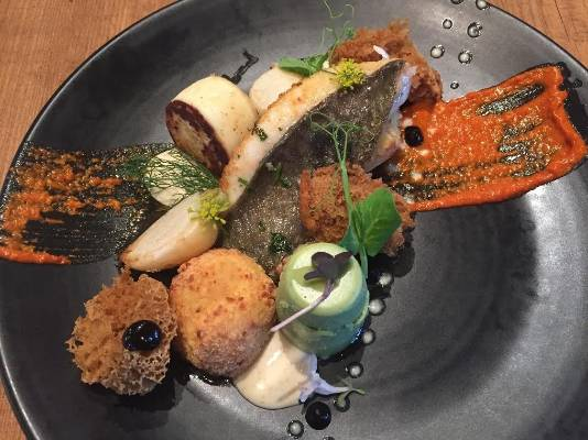 Bethany's goes for an ocean-themed plate with its black garlic sponge, Jon Dory cooked two ways served with macadamia ...