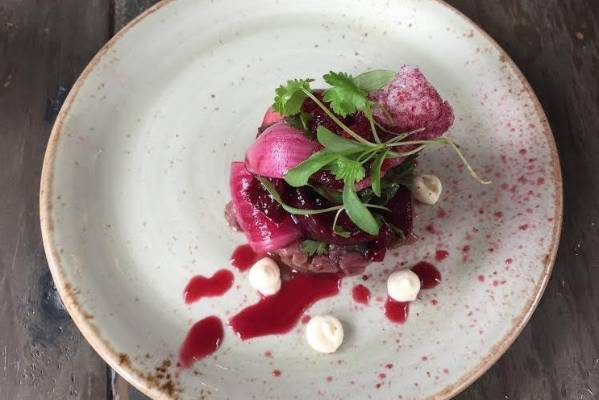 The Fat Farmer focuses on black doris plums, served with pickled onion petals, venison tartar and creme fraiche. This is ...