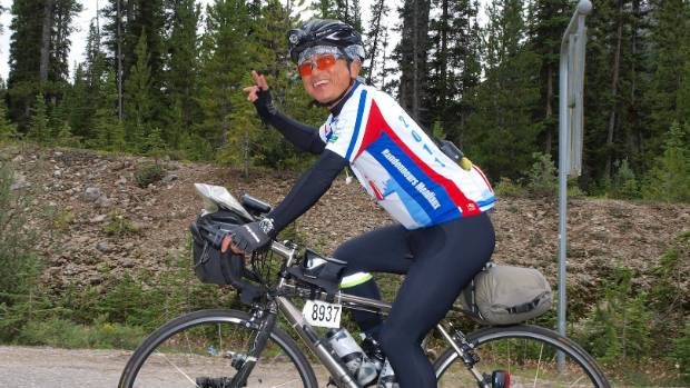 Mitsuaki Inagaki riding through the Rocky Mountains in 2012.