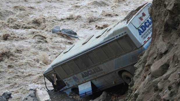 The rains causes many landslides, including one that hit this bus in Chosica, east of the capital Lima.