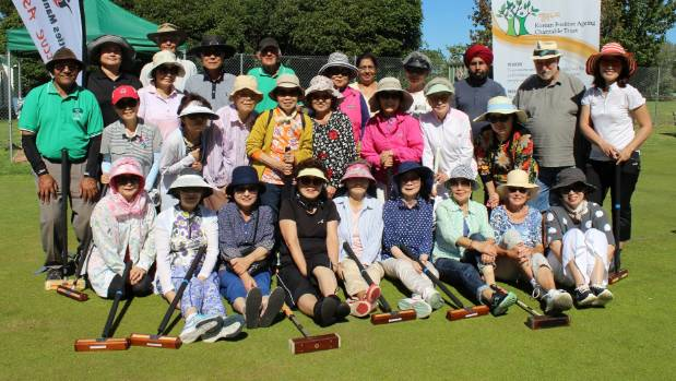 Senior students of the Korean Positive Aging Charitable Trust's Silver School and members of the Pakuranga Croquet Club ...