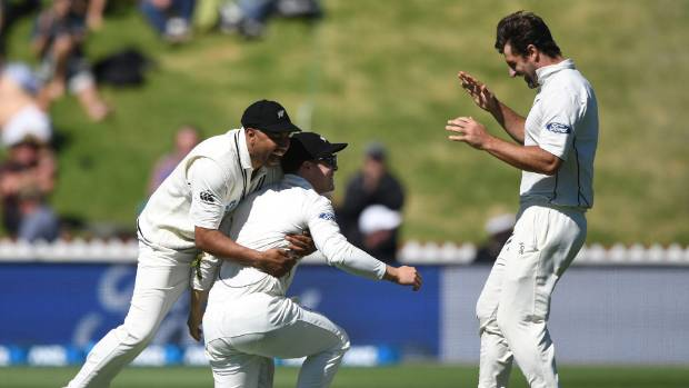 Another catch for Henry Nicholls and bowler Colin de Grandhomme, right, and Jeetan Patel help celebrate.