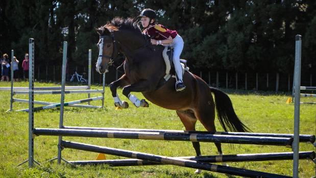 Alisha Macfarlane at the Waikato Interschool Show Jumping Championships. Earlier she had competed at the Horse of the ...