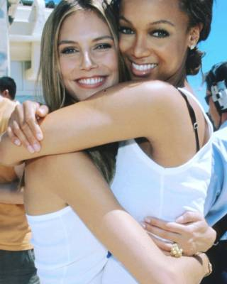 HEIDI KLUM: God bless a throwback. Klum is all cuddled up with Tyra Banks, and according to the caption this is from ...