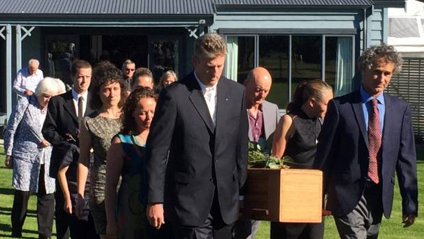 The late Maggie Lawton's family carry her casket from her funeral.