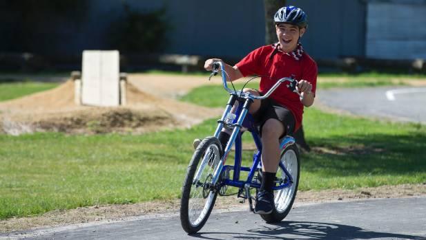 Te Kura o Takaro pupil Nikau Taylor, 11, having a blast riding his chopper.