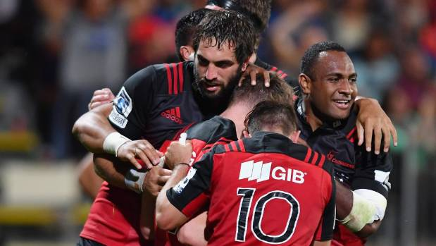 Skipper Sam Whitelock and Crusaders team-mates celebrate Mitchell Drummond's late try against the Blues.