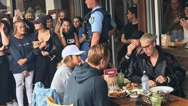 There's no such thing as a relaxed lunch in Sydney with your friends when you're Justin Bieber.