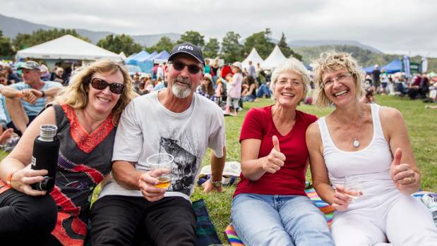 From left, Kathy Milam, Paul Leedom, Sylvia Gregory and Nicolette Fee enjoy a drink by the main stage at the War ...