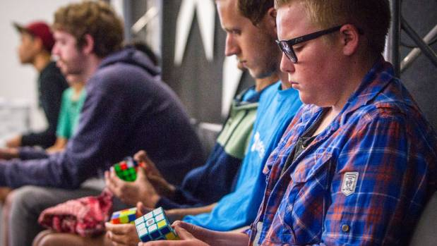 What do you do when waiting to compete in a speed-Rubik's cube competition? Brush up on your skills.