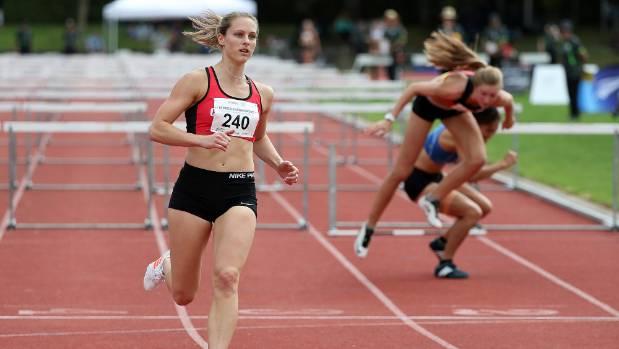 Canterbury's Fiona Morrison crosses to win the women's 100m hurdles in Hamilton.