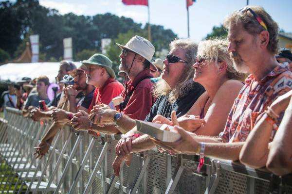 Festival goers get the best vantage points before the next artist comes on stage.
