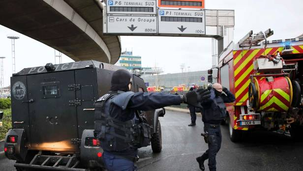 Police arrive at Orly Airport's southern terminal after the shooting.