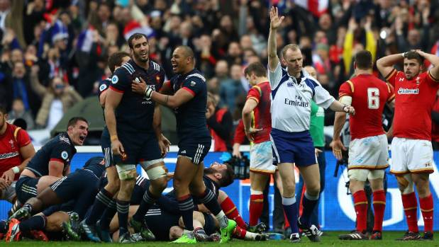 Referee Wayne Barnes awards a late try to Damien Chouly during the Six Nations match between France and Wales in Paris. ...