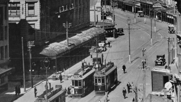 Streetcars on the go in Lambton Quay, outside Kirkcaldie & Stains store, in 1922.