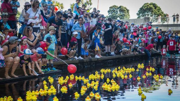 Duck races on the Huatoki Stream beside the Puki Ariki Landing, New Plymouth to raise money for the New Zealand Red Cross.