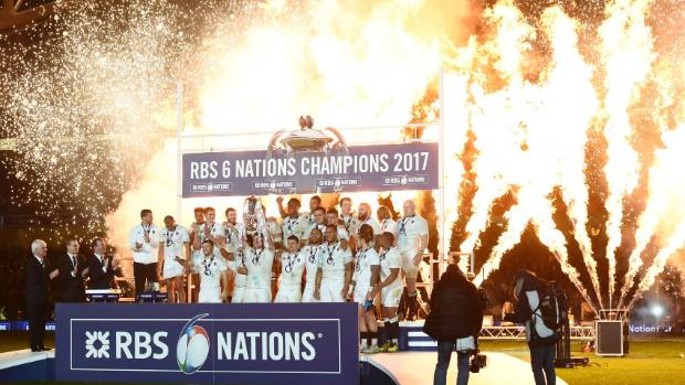 England celebrate with the Six Nations trophy after the loss to Ireland.