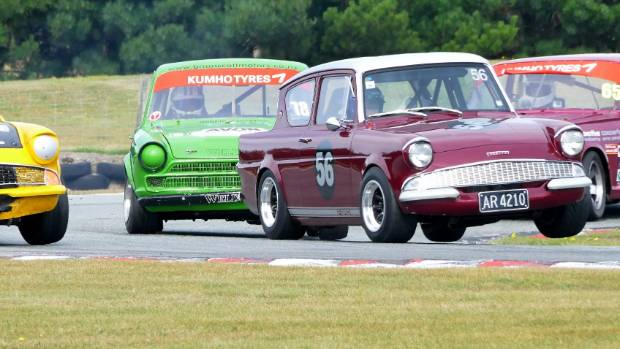 Ewan Macpherson of Invercargill in Car 56 lifting both inside wheels as he corners hard while leading  the Pre 65 ...
