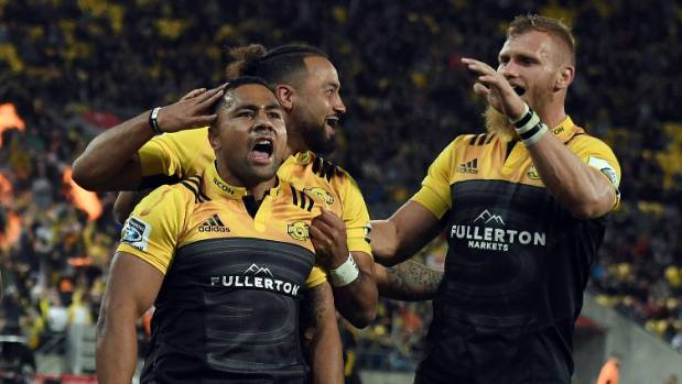 Hurricanes player Ngani Laumape (left) celebrates his try during Super Rugby match against the Highlanders.