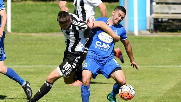 Hamilton Wanderers' Alexis Varela and Hawke's Bay United's Angus Kilkolly competing for the ball.