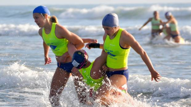 Competitors in a beach rescue event at the 2017 national surf life saving championships in Christchurch.