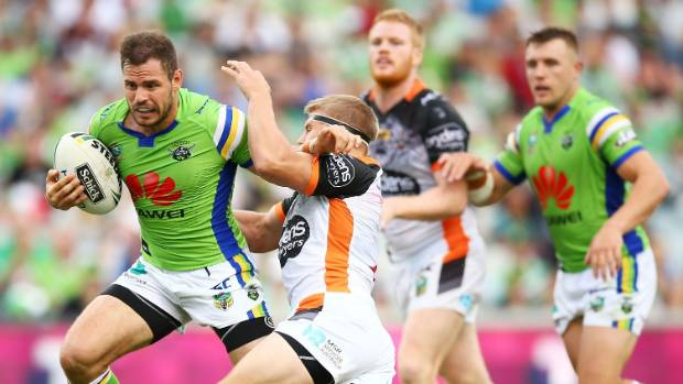 Aidan Sezer of the Raiders makes a line break during the round three NRL match against the Wests Tigers in Canberra.