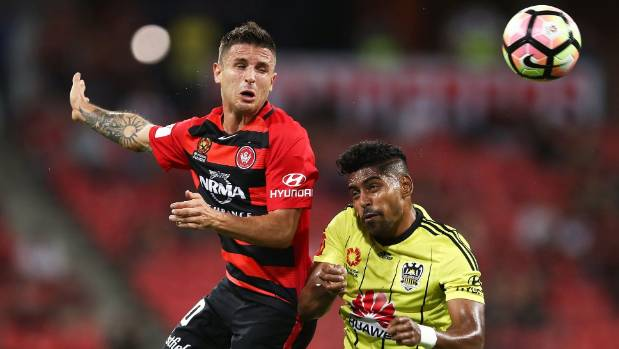 Western Sydney Wanderers midfielder Nicolas Martinez competes for a header with Roy Krishna of the Wellington Phoenix.