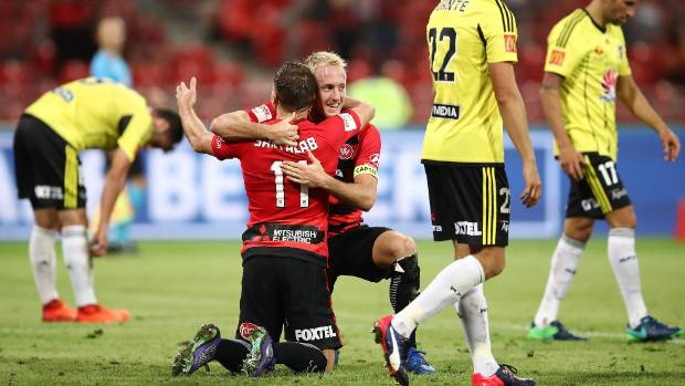 Western Sydney Wanderers striker Brendon Santalab is embraced by team-mate Mitch Nichols after scoring his second goal ...