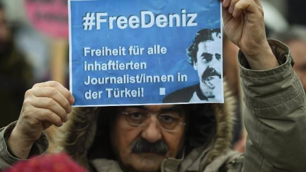 A protester demands the release of jailed Turkish-German journalist Deniz Yucel in Hamburg, Germany on March 7.