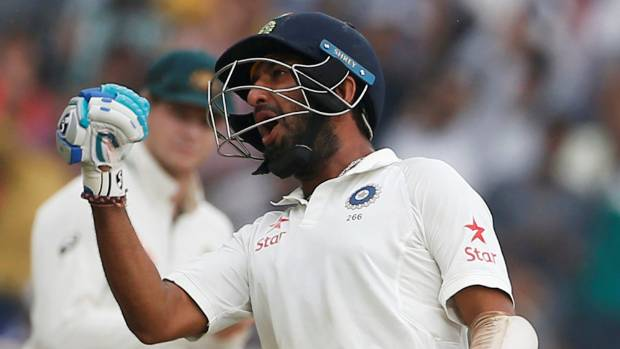 Indian batsman Cheteshwar Pujara celebrates his double century.
