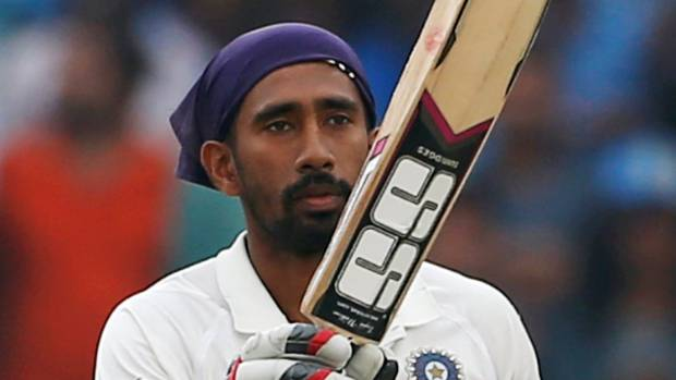 India's Wriddhiman Saha celebrates his century.