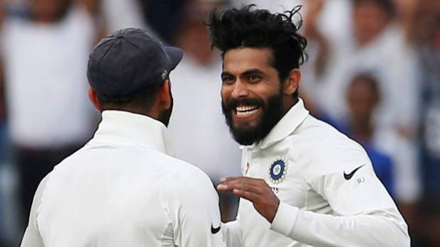 India's Ravindra Jadeja (R) and Virat Kohli celebrate the dismissal of Australian opener David Warner.