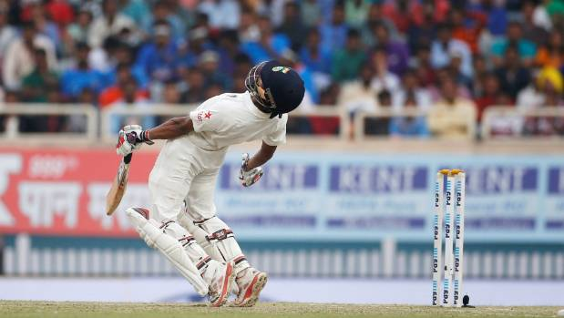 India's Wriddhiman Saha evades a bouncer.