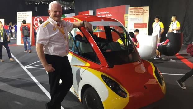 Shell's chief scientist of mobility Dr Wolfgang Warnecke with the little concept car on display at Singapore.