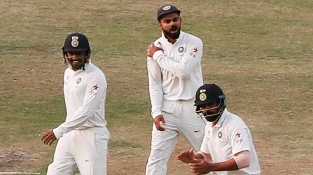 India captain Virat Kohli celebrates the late day four dismissal of Australia nightwatchman Nathan Lyon.